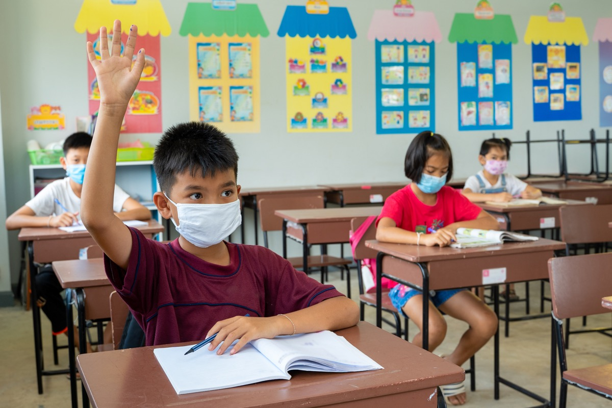 Students socially distanced in class wearing masks during coronavirus pandemic back to school