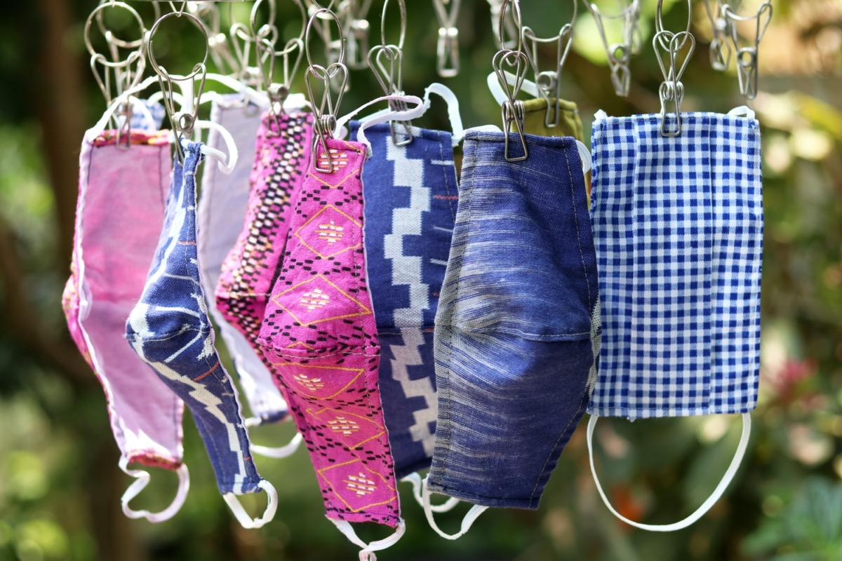 cloth face masks drying on clothesline amid coronavirus pandemic