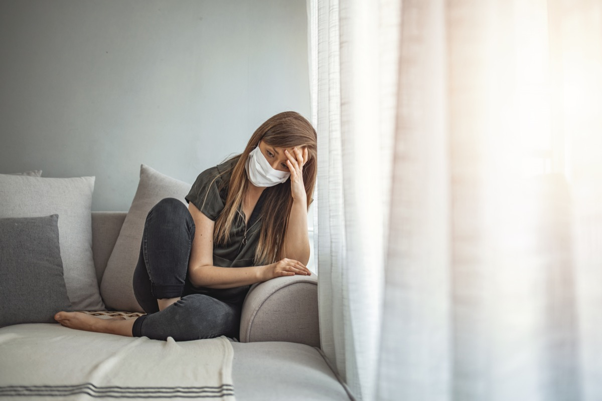 Sad lonely girl isolated stay at home in protective sterile