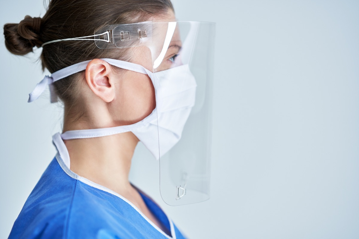 Health care professional wearing face shield and face mask PPE