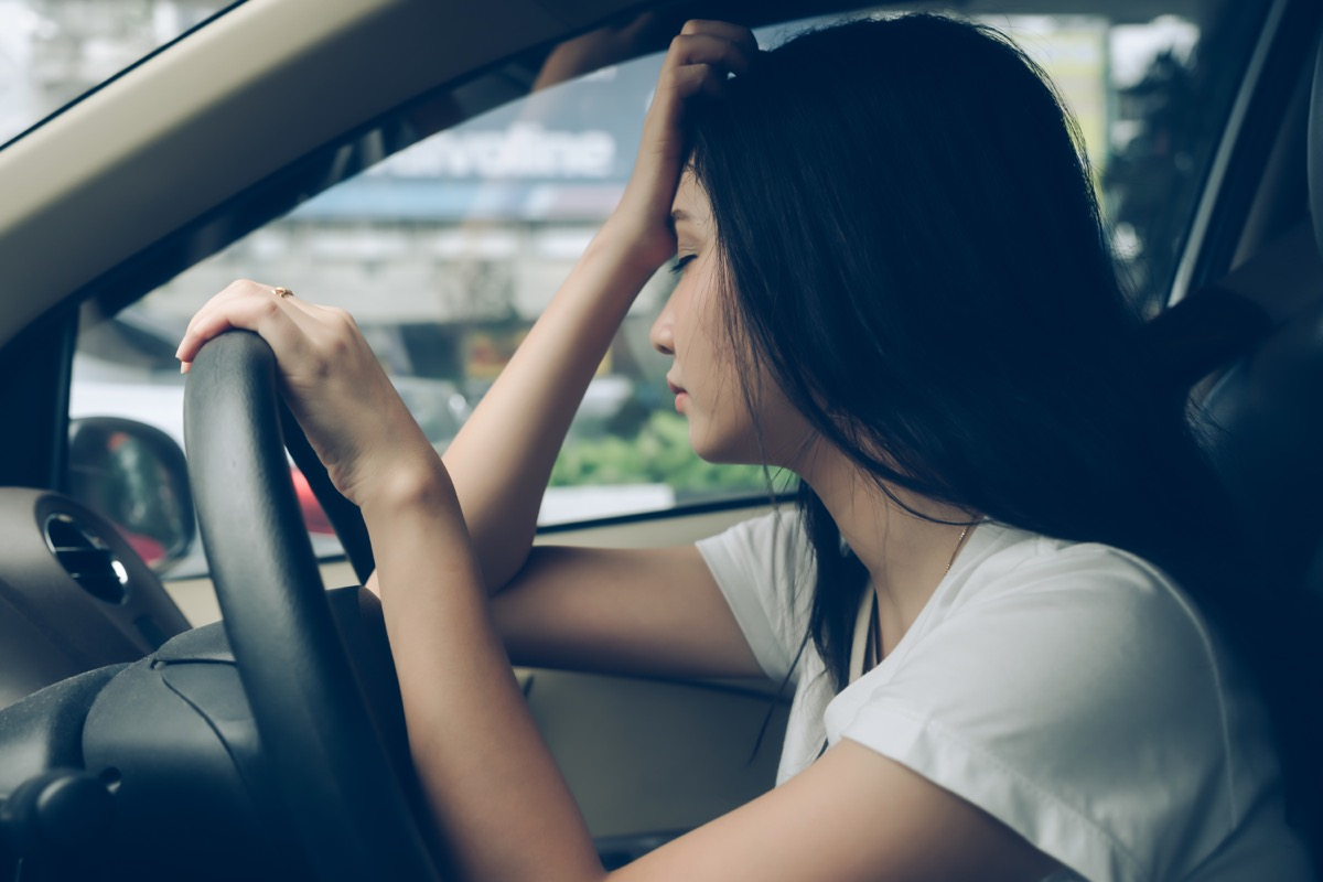 Woman experiencing fatigue while driving