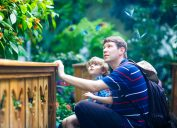 Father and son in a botanical garden