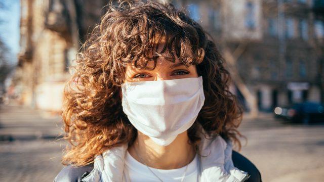 Girl wearing a mask outside