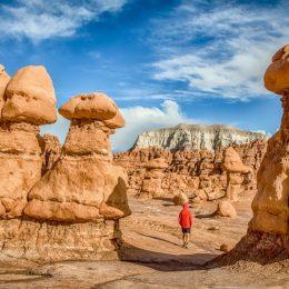 man walks in goblin valley state park