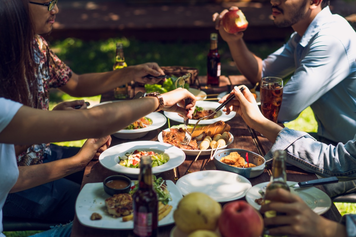 Friends eating at a barbecue
