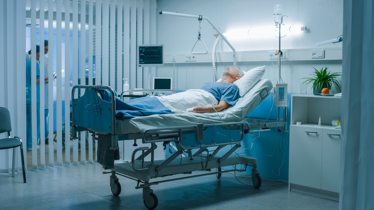 Man laying in hospital bed with coronavirus