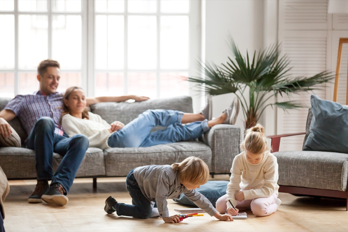 Kids playing and parents lounging in their house during the coronavirus pandemic