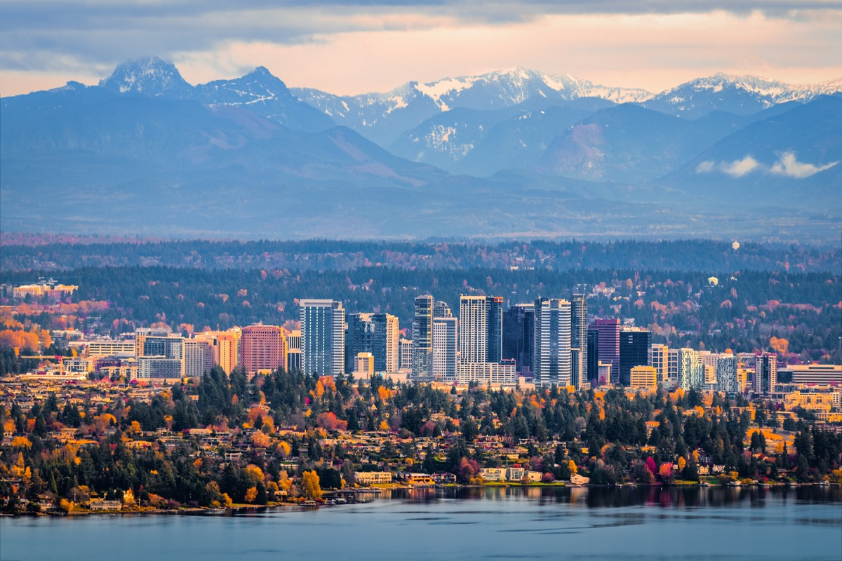 Bellevue Washington. The snowy Alpine Lakes Wilderness mountain peaks rise behind the urban skyline.