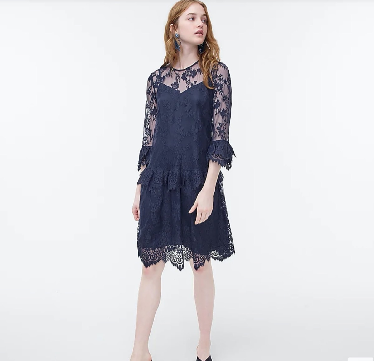 young white woman in blue lace dress