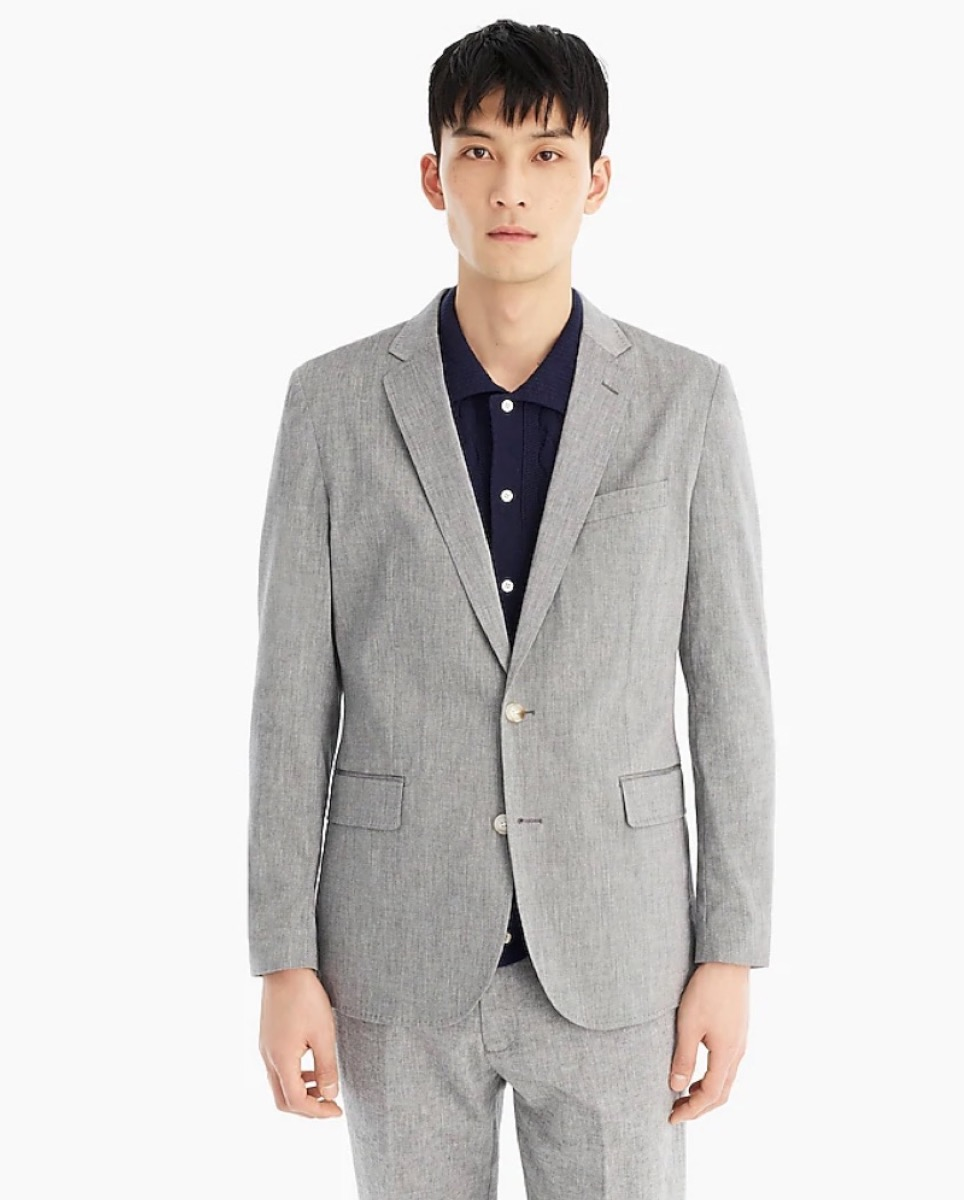 young asian man in gray suit