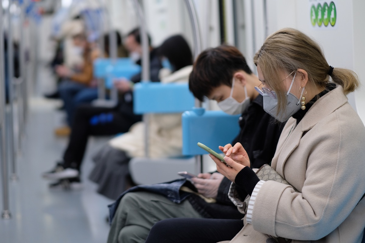 People wearing masks on train