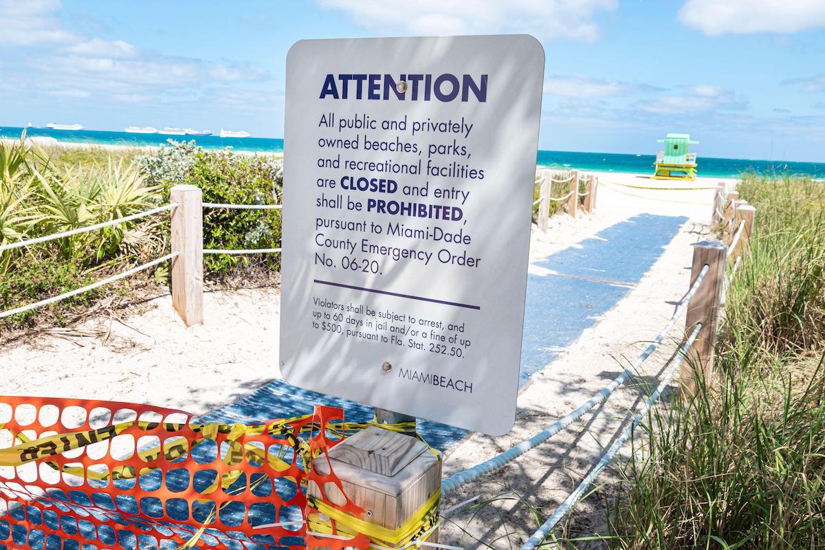Miami Beach closed with coronavirus pandemic warning sign