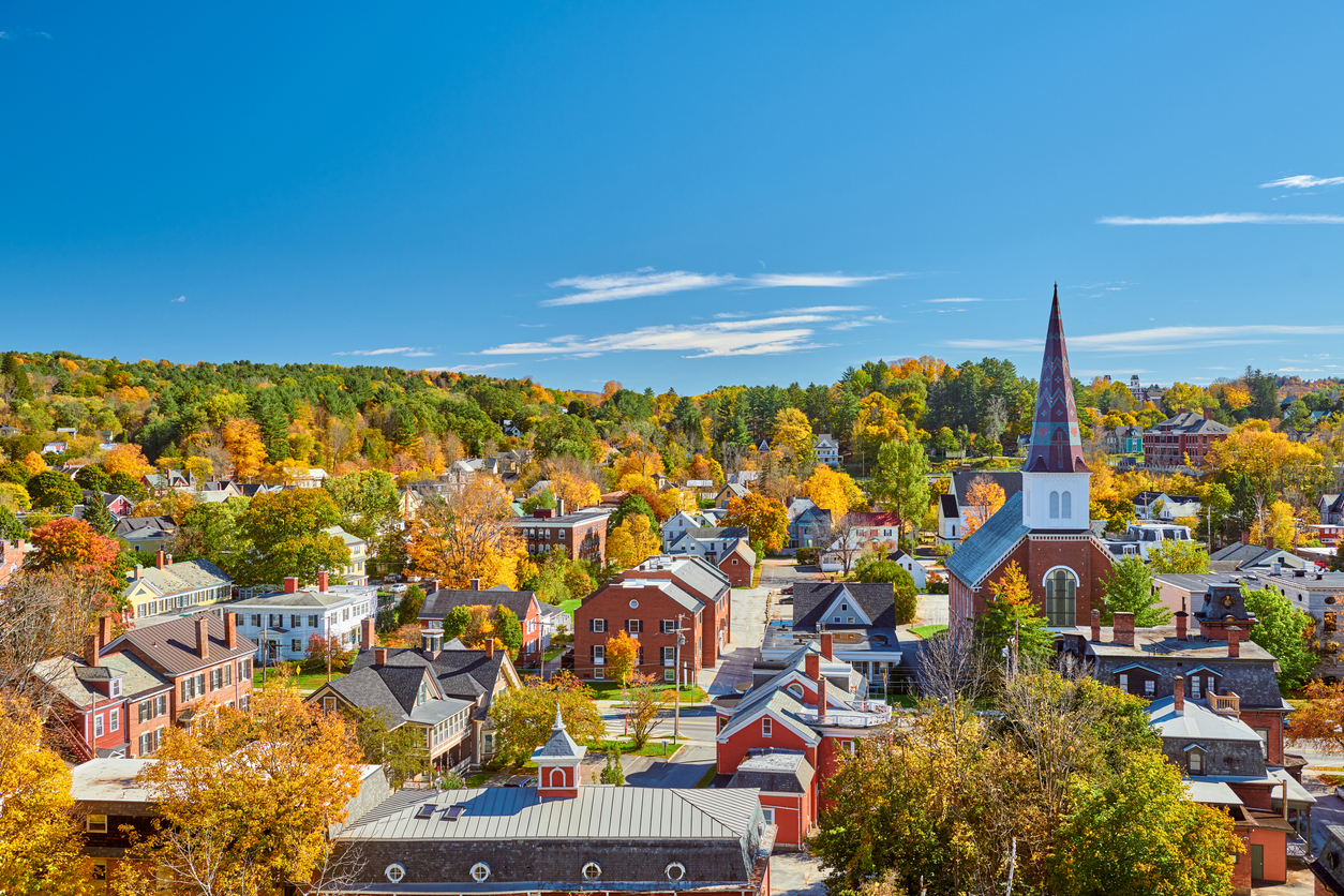 The skyline of Montpelier, Vermont in autumn with brick buildings and a church steeple