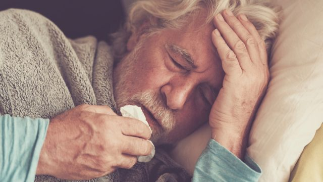 older white man with fever from coronavirus