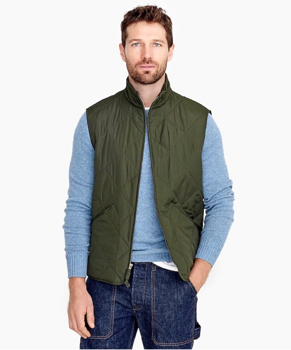 young white man in green vest