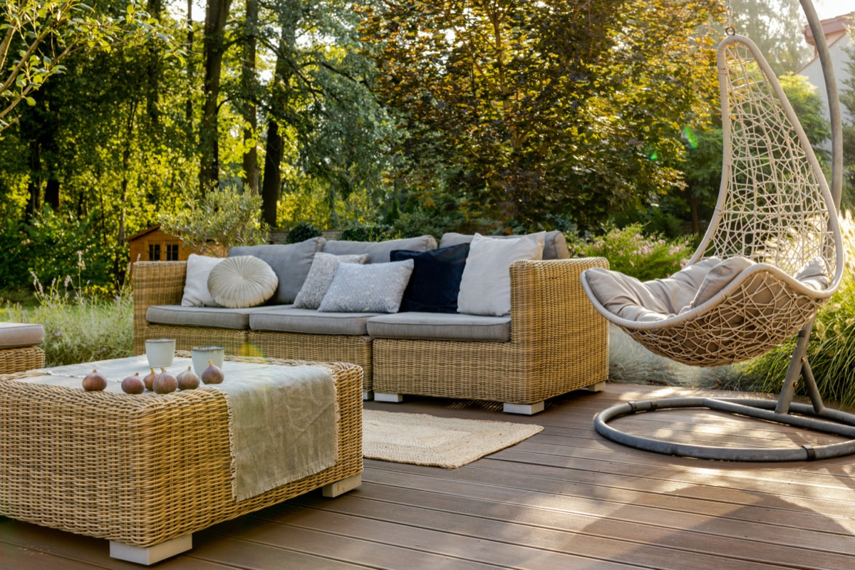 modern outdoor wicker or rattan furniture set up on patio