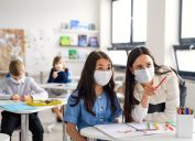 Teacher and students wearing masks during coronavirus pandemic back to school