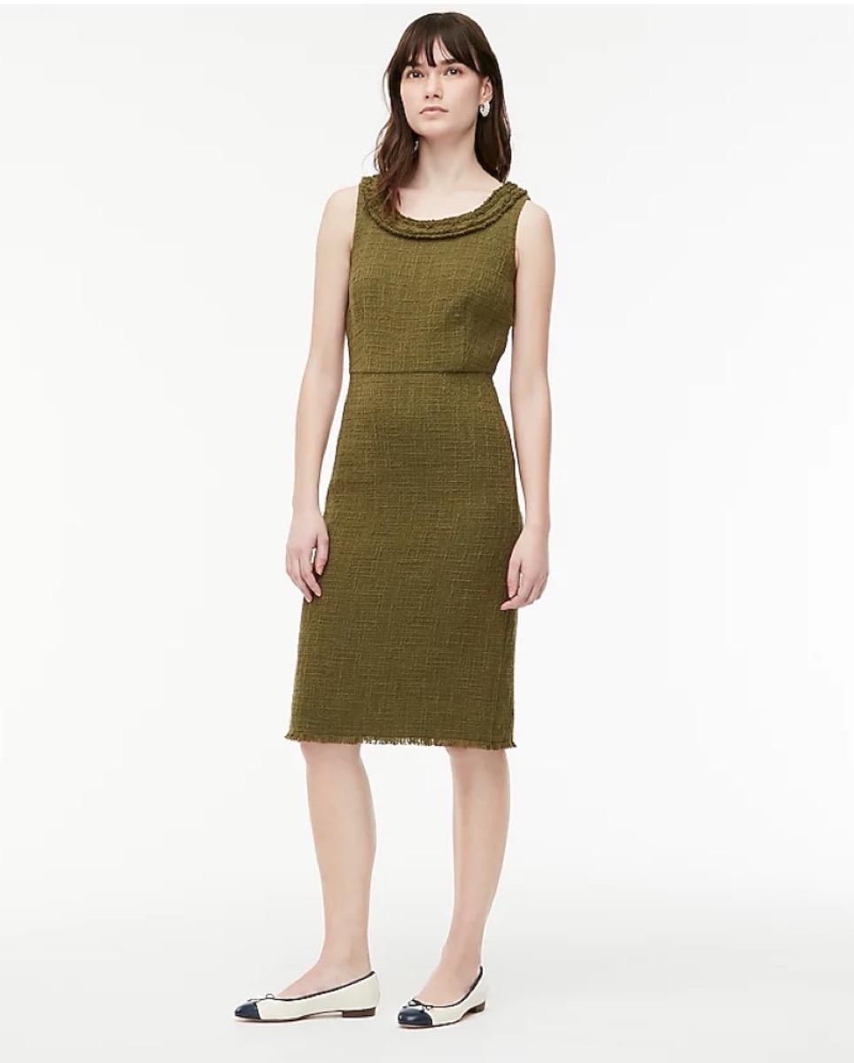 young white woman in green sheath dress