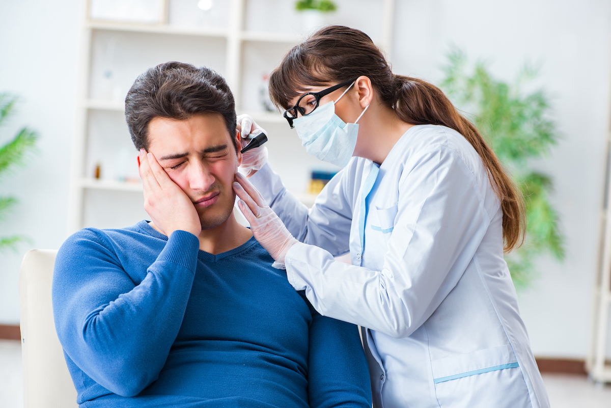 Doctor looking at patient's ear