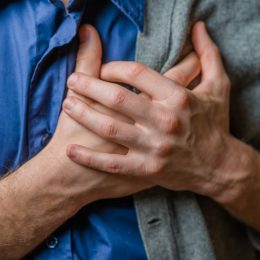 Person suffering from heart pain
