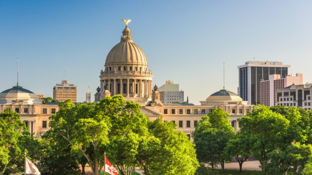 The downtown skyline of Jackson, Mississippi with the state house in the foreground