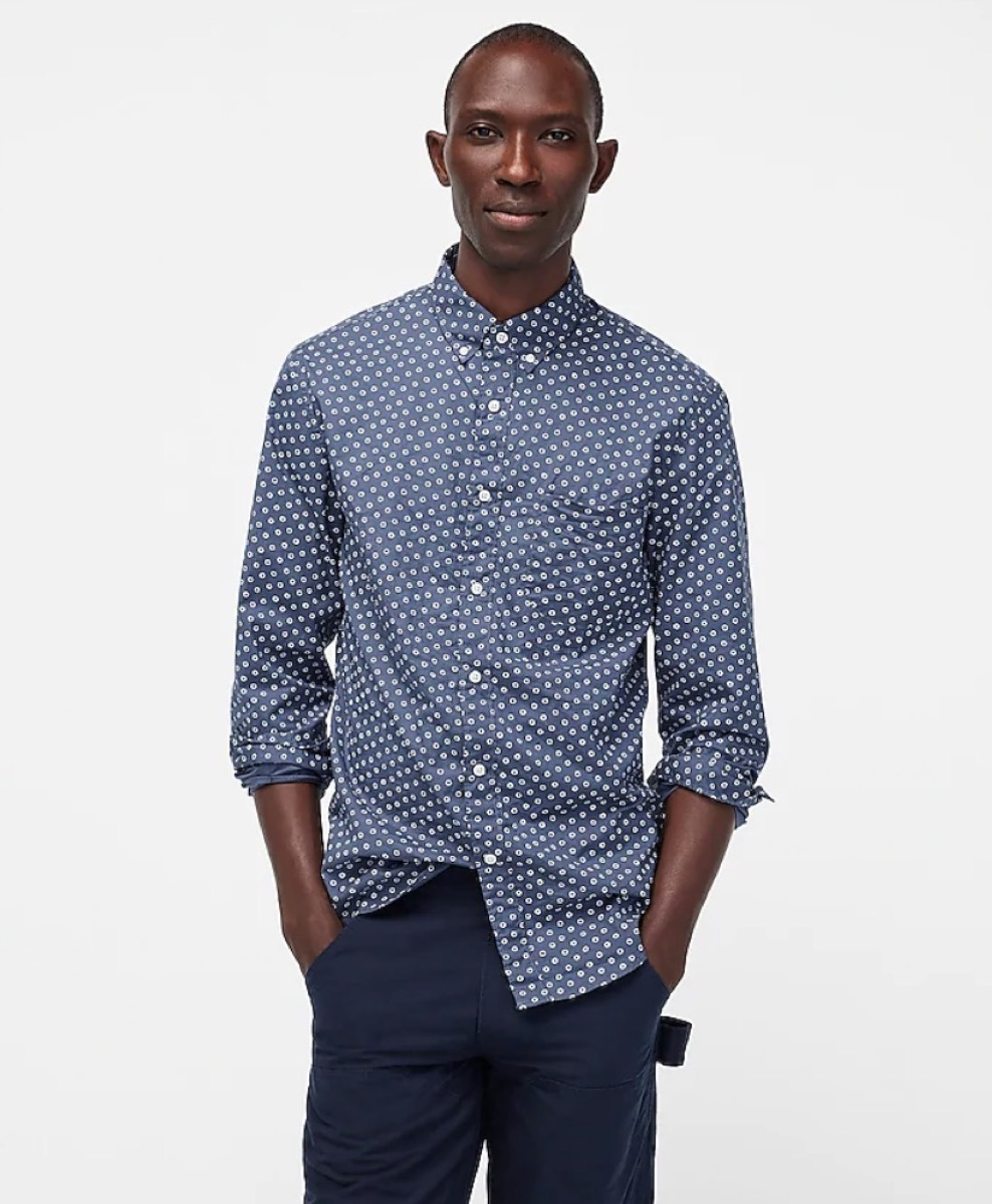 young black man in blue button down shirt