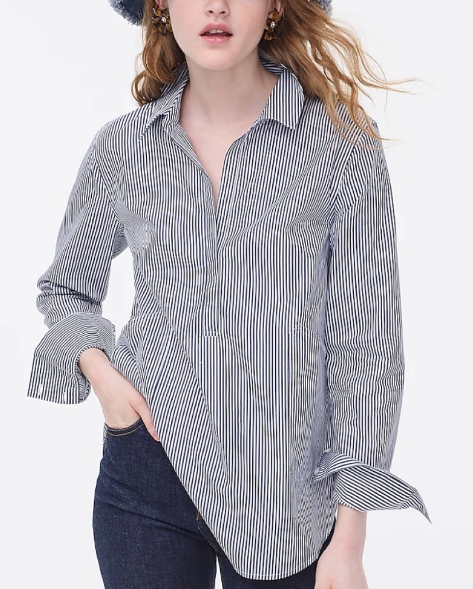 young white woman in cotton tunic shirt