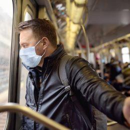 Man wearing a mask the subway