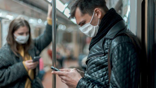 People wearing masks on subway