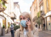 senior woman wearing mask on phone