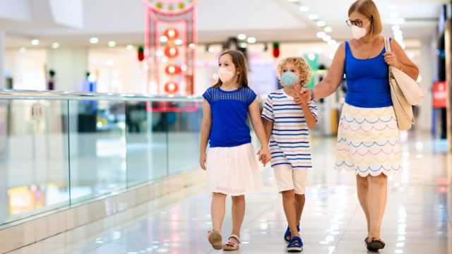 middle aged white woman shopping with kids