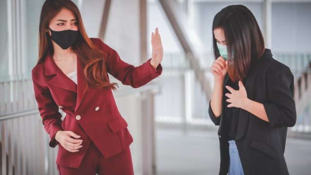 woman fears getting COVID from friend who is coughing