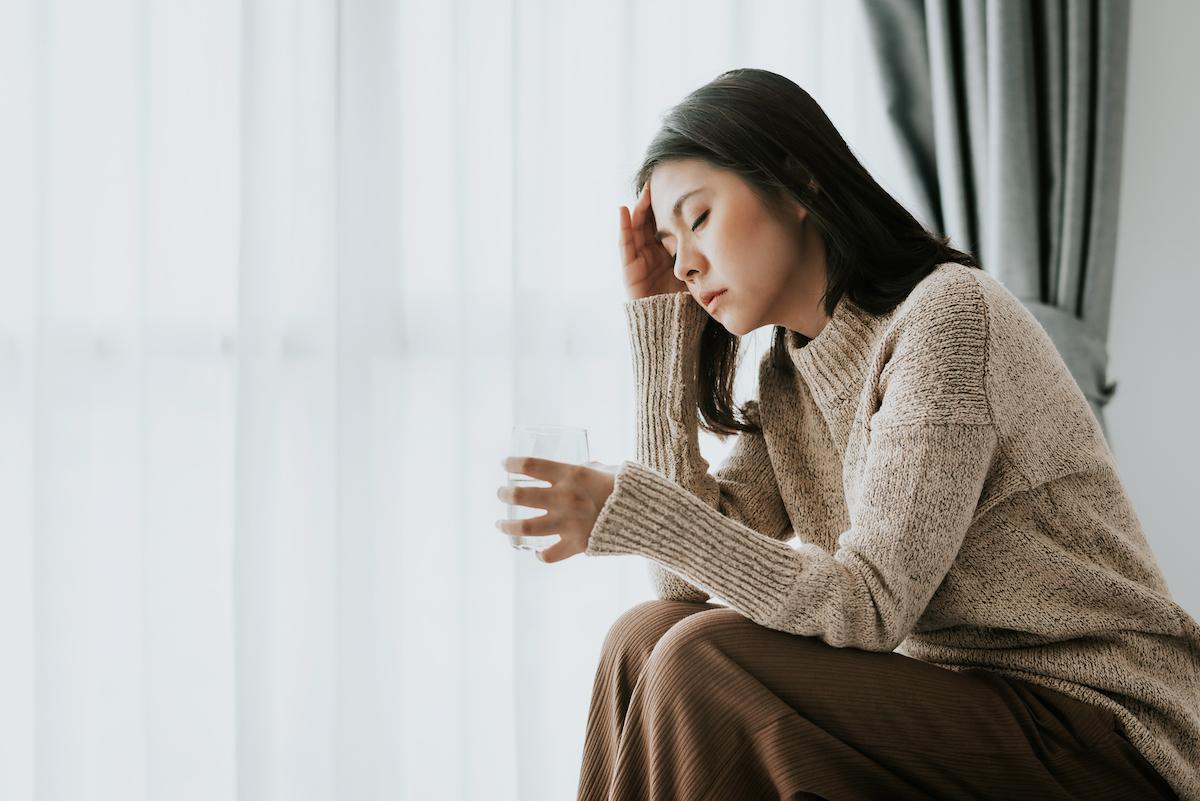 Asian woman not feeling well