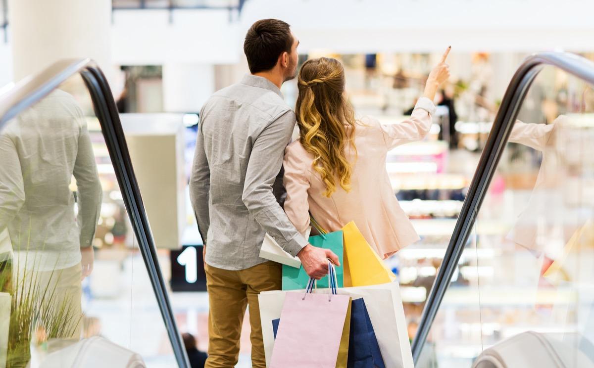 Couple on mall escalator
