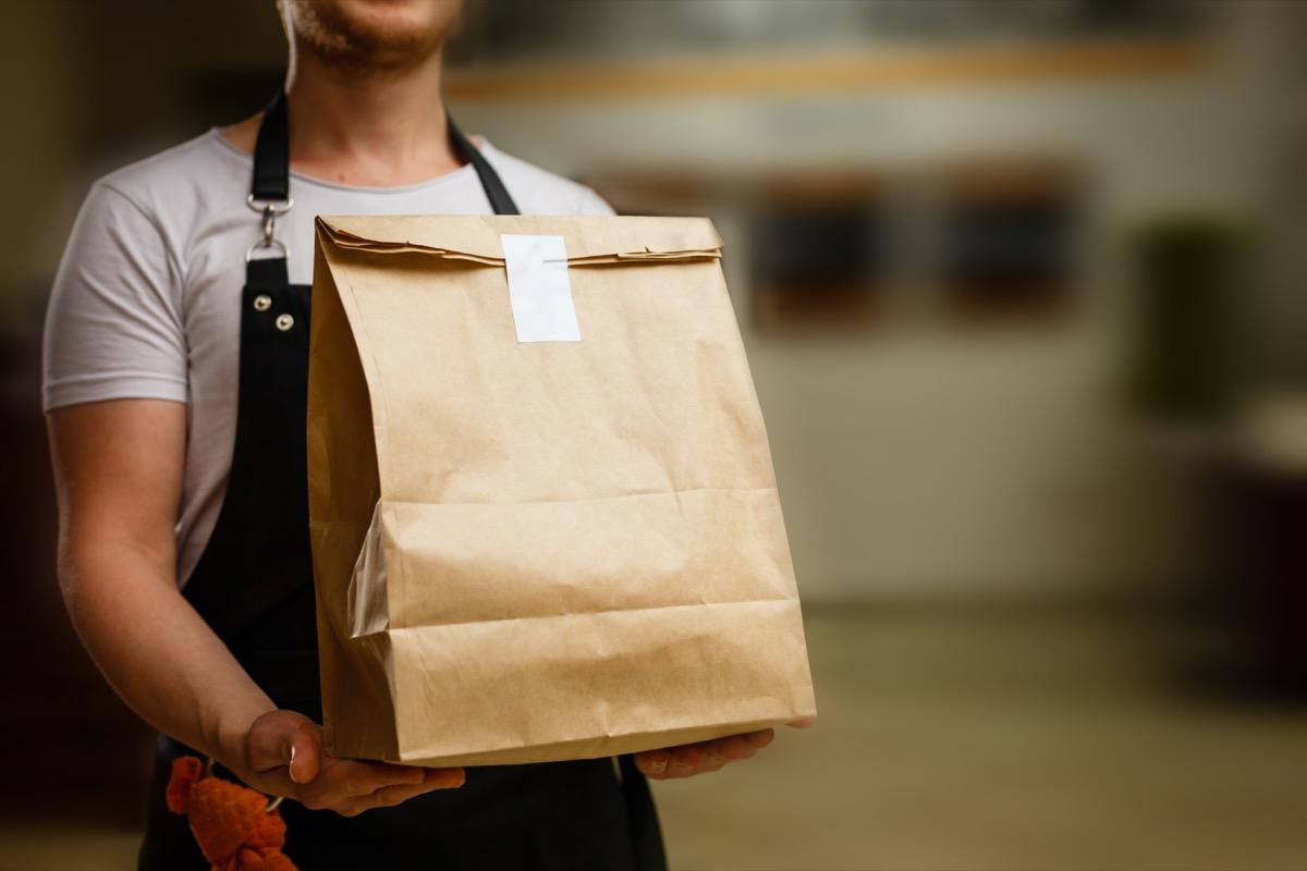 Delivery guy holding bag