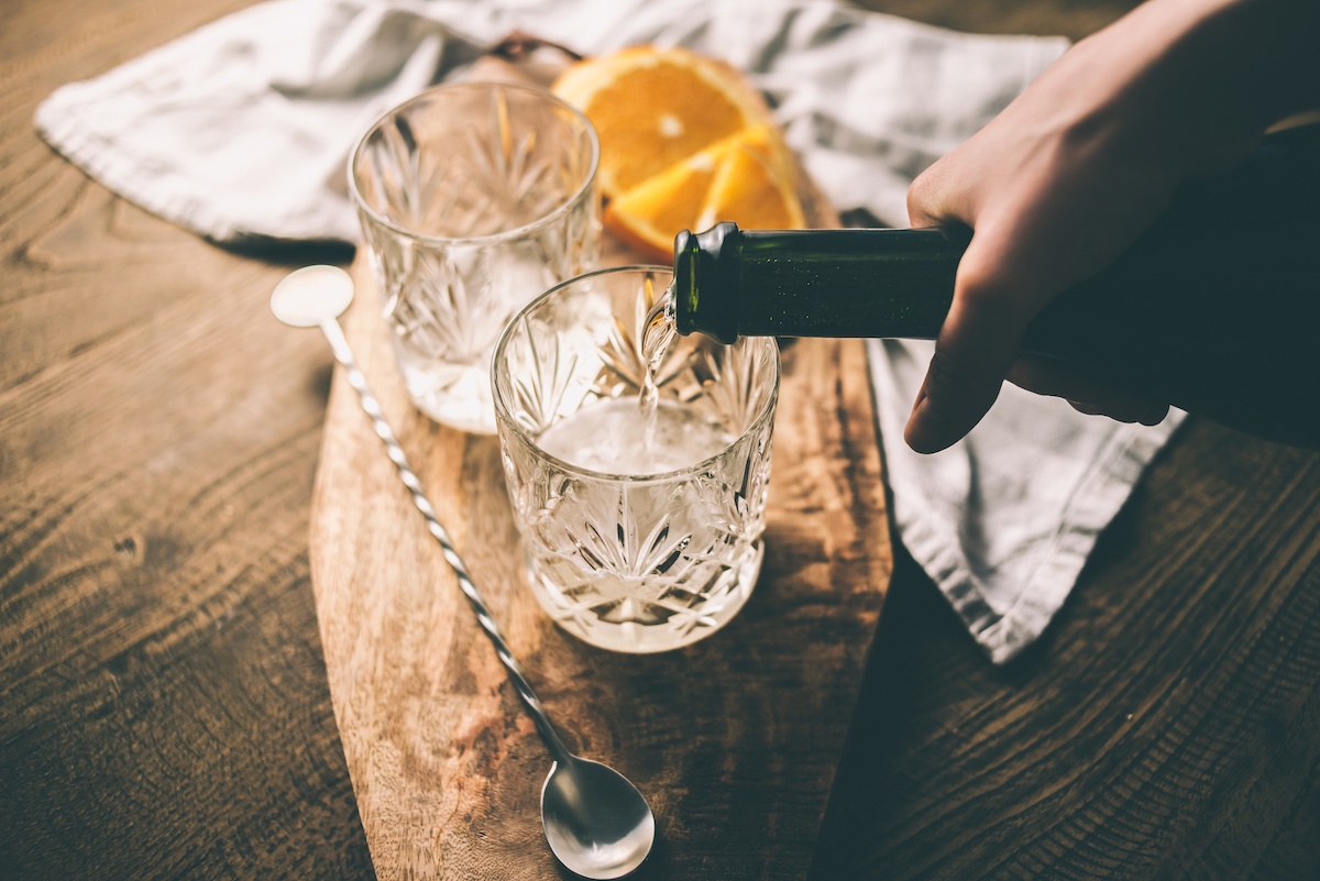 Pouring a drink into cocktail glass