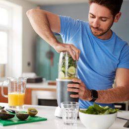 Man making green juice