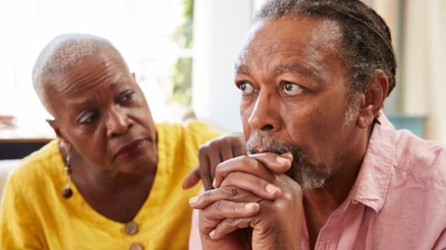 Older black man and woman depressed