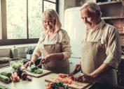 Older couple cooking vegetables