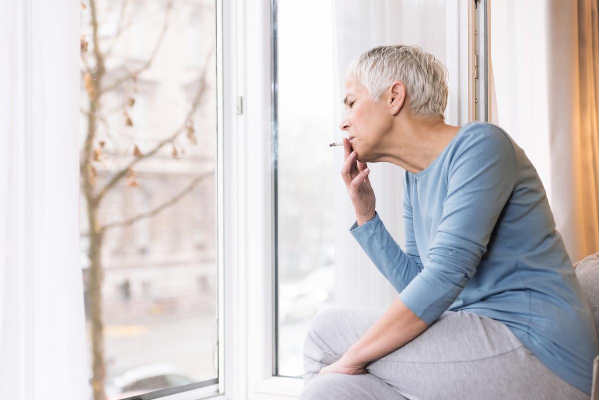 Older woman smoking unhealthy