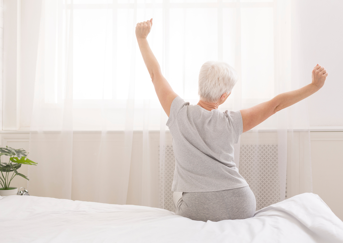 Older woman waking up refreshed