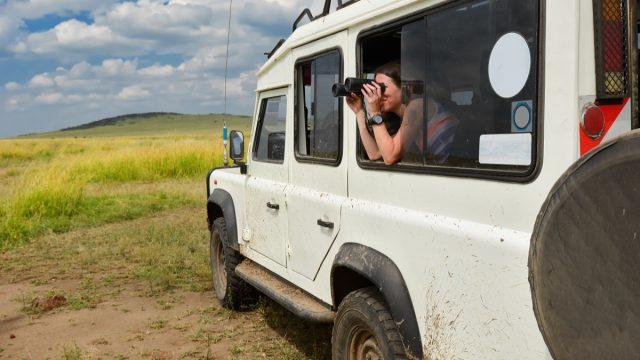 Woman on safari with binoculars