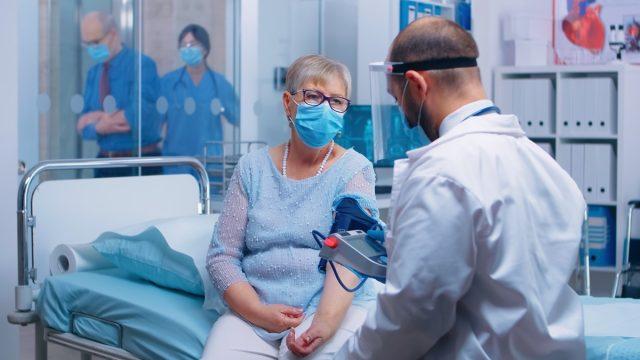 Senior woman having blood pressure taken