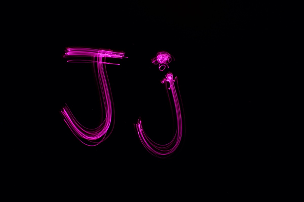 Uppercase and lowercase letter j in pink neon