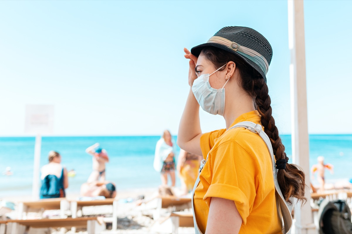 Woman at beach in mask