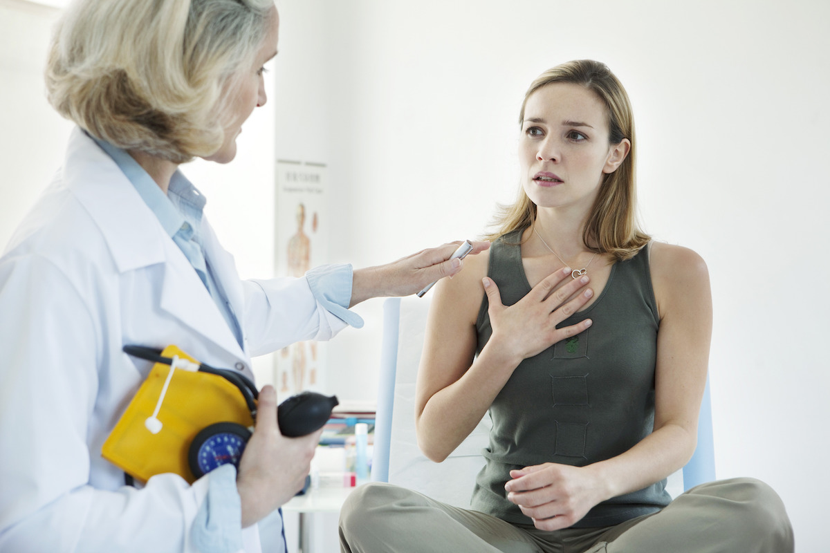 Woman at the doctor being treated for asthma