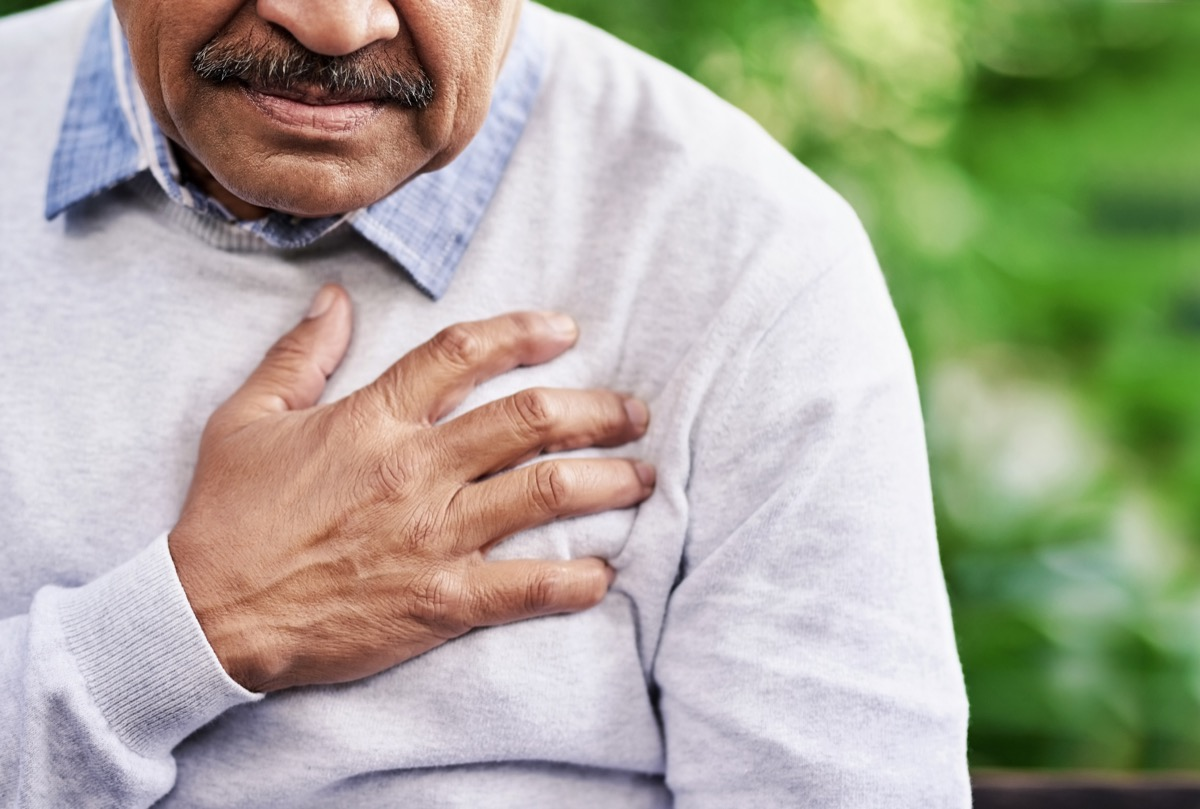 Man holding his chest because of heart pain