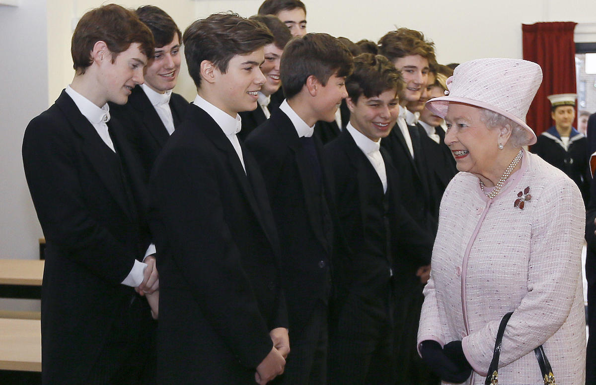 Queen Elizabeth II meets Eton pupil Arthur Chatto, grandson of her late sister Princess Margaret, during a visit to Holyport College near Maidenhead, Berkshire, in 2014.