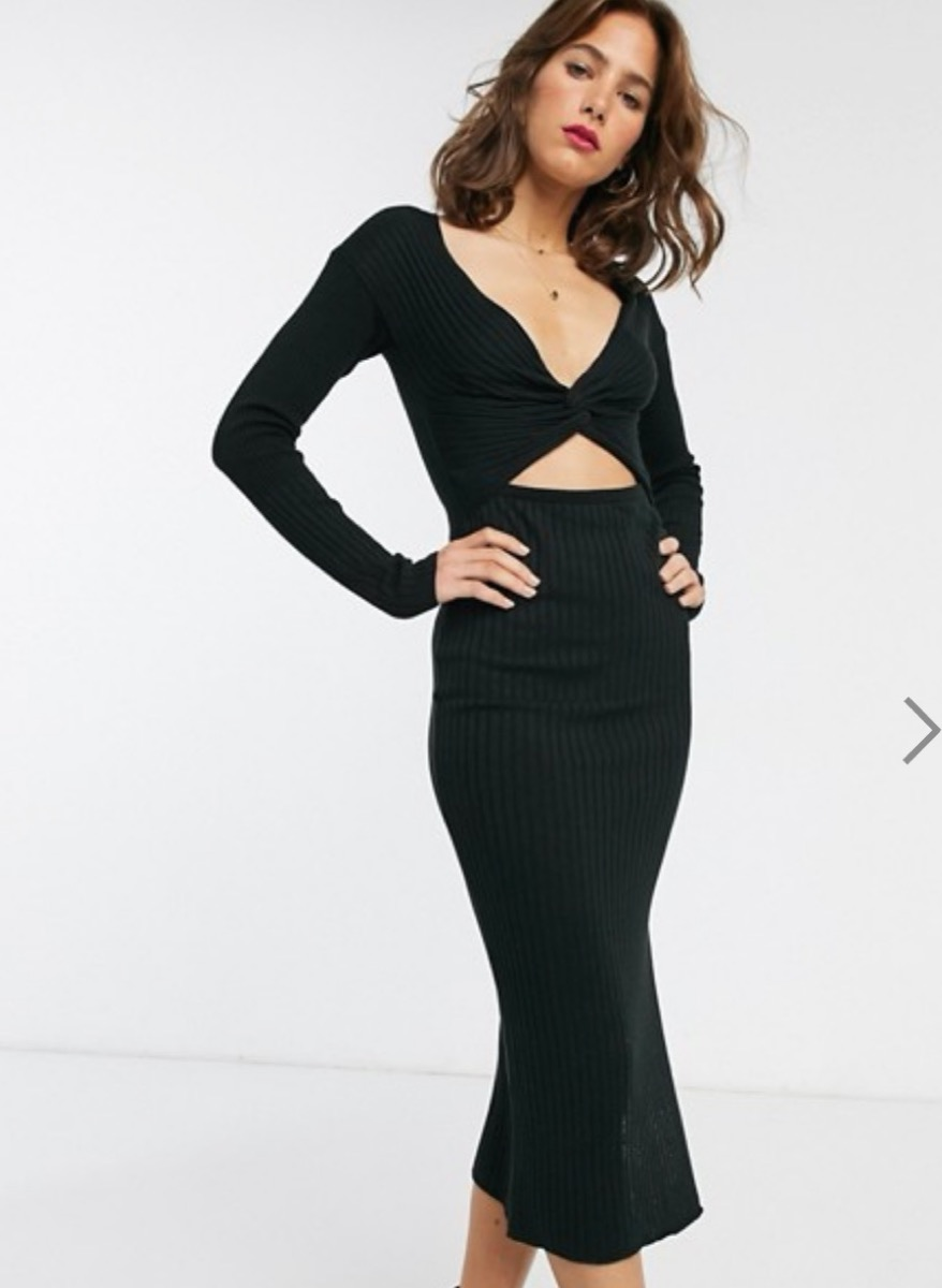 white model in long black dress with midriff cutout