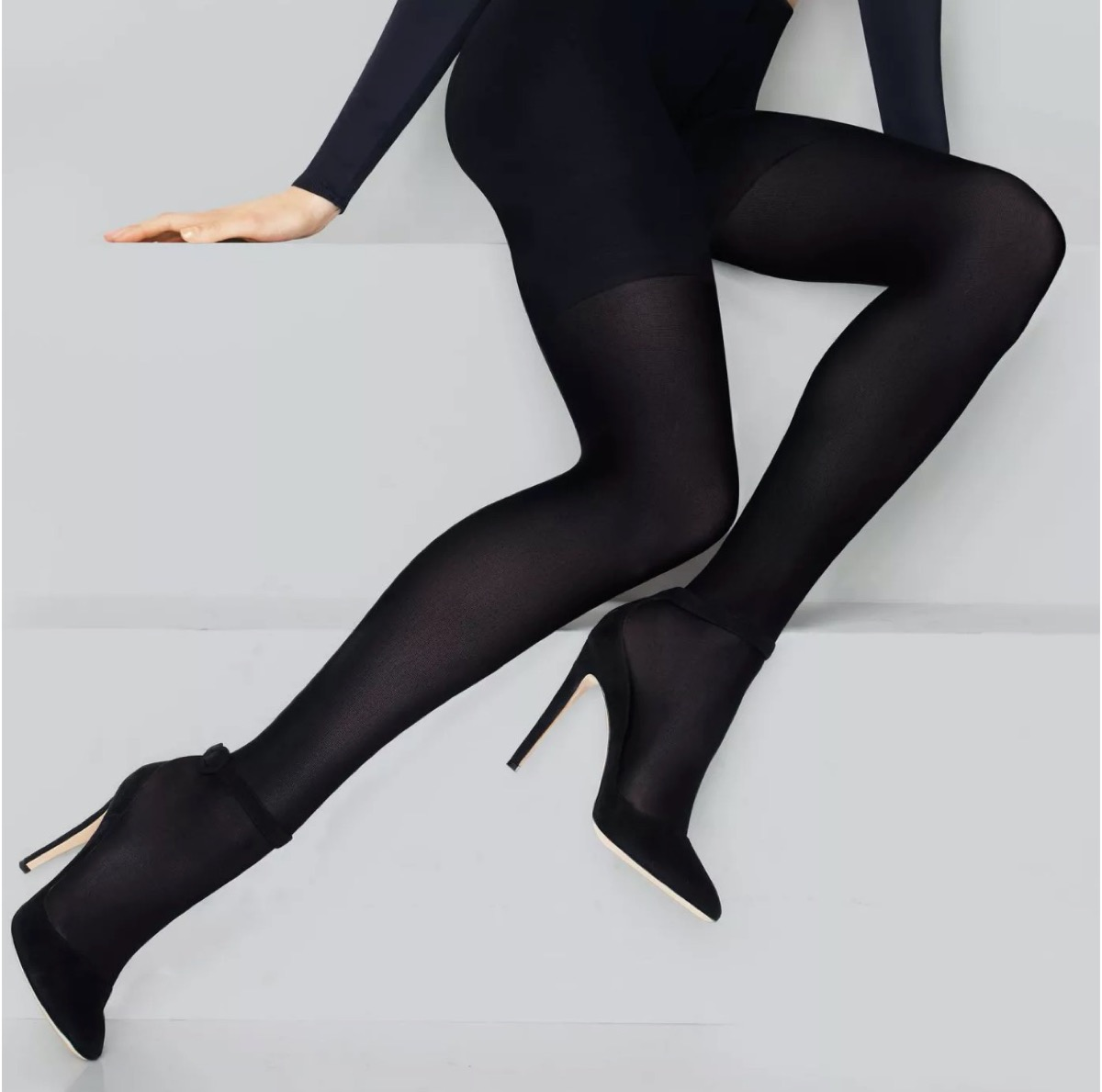woman in black tights and heels